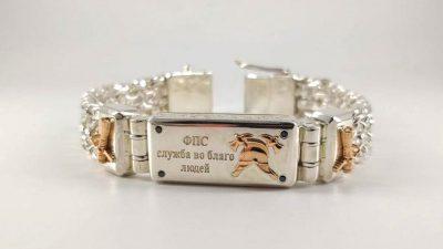 Браслет из серебра с пожарной символикой из золота