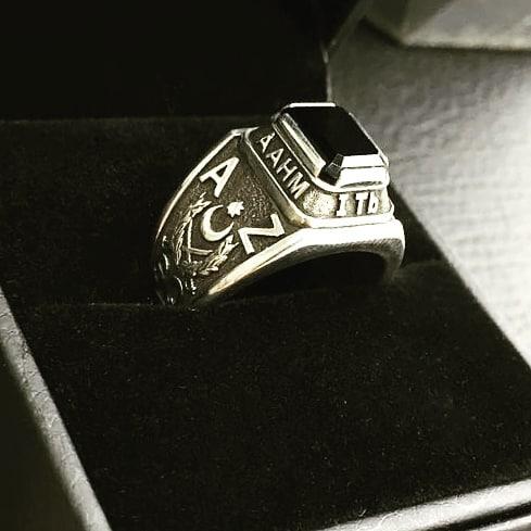 Серебряный перстень-печатка с камнем и логотипом
